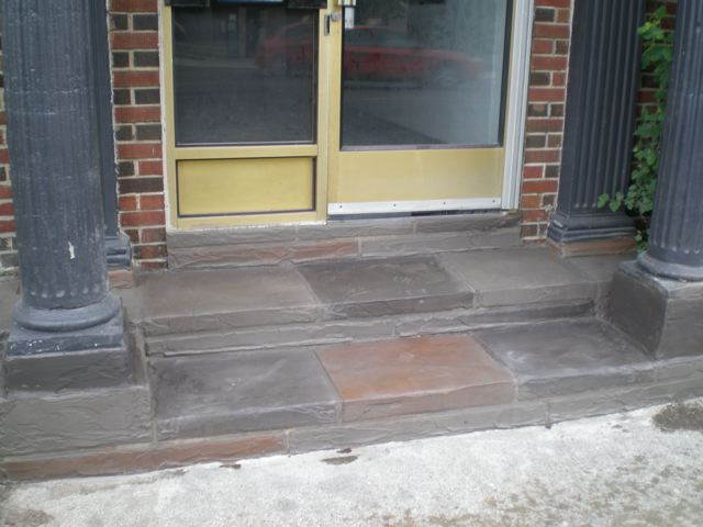 Look down. The steps have been re-done at 1165 Kingston Rd